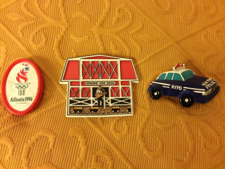 Fridge magnets: Atlanta 1996 Olympics; Grand Ole Opry; NYPD car