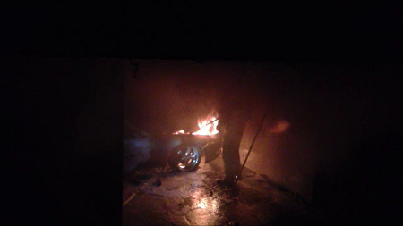 After most of the fire had been put out, more flames emerged from under the car's bonnet