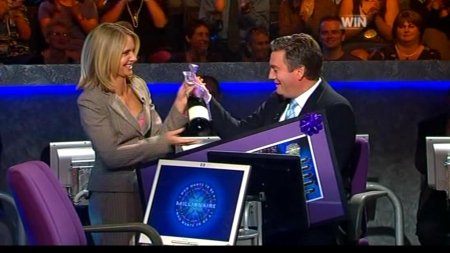 Livinia Nixon presents Eddie McGuire with some farewell gifts