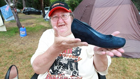 Pat Eatock holding Julia Gillard's stolen shoe. Picture h/t Gary Ramage of The Daily Telegraph