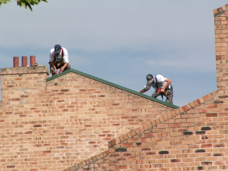 People working on a roof in Argyle Square