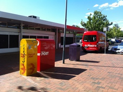 The Australia Post post office and an Australia Post van in Dickson, ACT