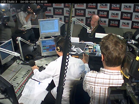 Alan Jones in the 2GB Studio with a lot of cameras