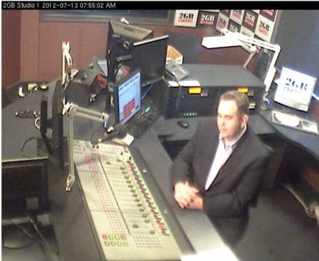 Andrew Moore in the 2GB Studios during a live cross to Seven's Sunrise program, as seen on the 2GB webcam. 13 July, 2012. Image credit: Macquarie Radio Network