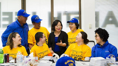 Elizabeth Lee prepares election material with her team at her office in the city. Back, from left: David Lee, John Lee (father), Elizabeth Lee, Cecilia Lee (mother), Front, from left: Candice Burch, Samuel Gordon-Stewart, Rosa Lee (sister), and Kim Lee. Photo: Rohan Thomson. Source: The Canberra Times, October 8, 2012