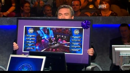Eddie McGuire shows off the Who Wants To Be A Millionaire picture