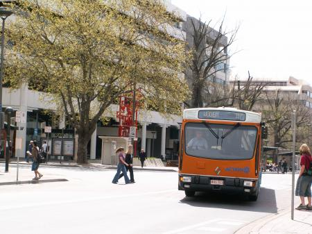 A nice orange ACTION bus
